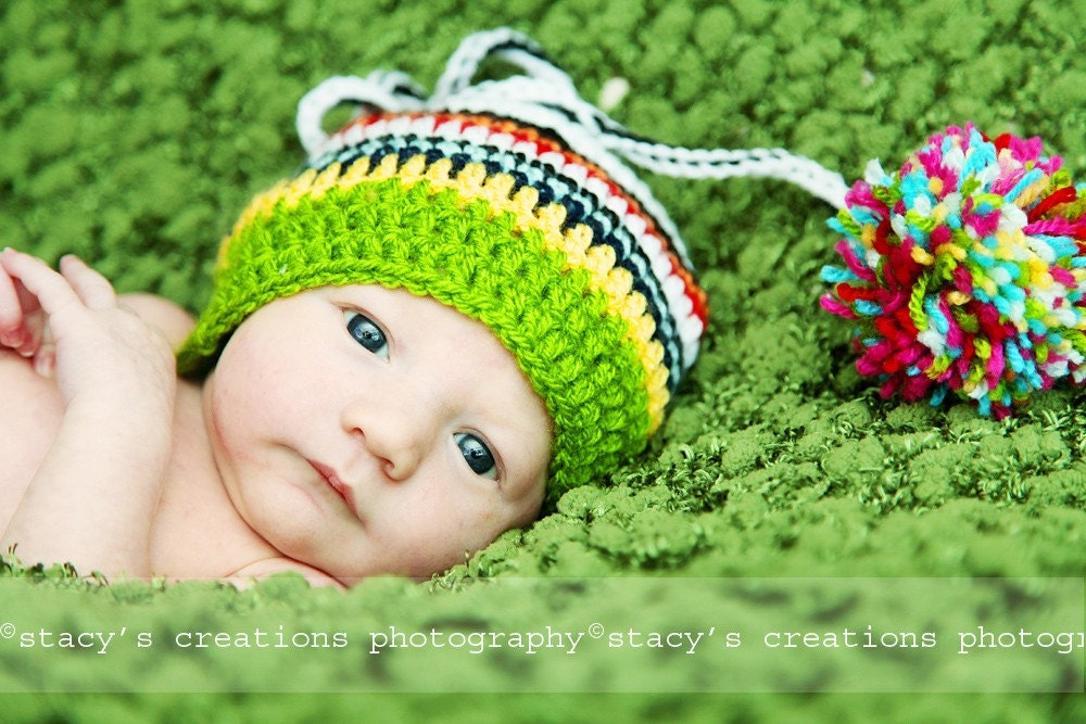 Multicolored striped Elf-hat with adjustable cord and pom pom. Great for a newborn photo prop or for a gift..Sizes 0-12 month. Item 059