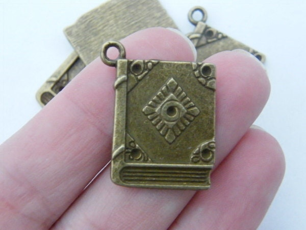 4 Book charms antique bronze tone BC98