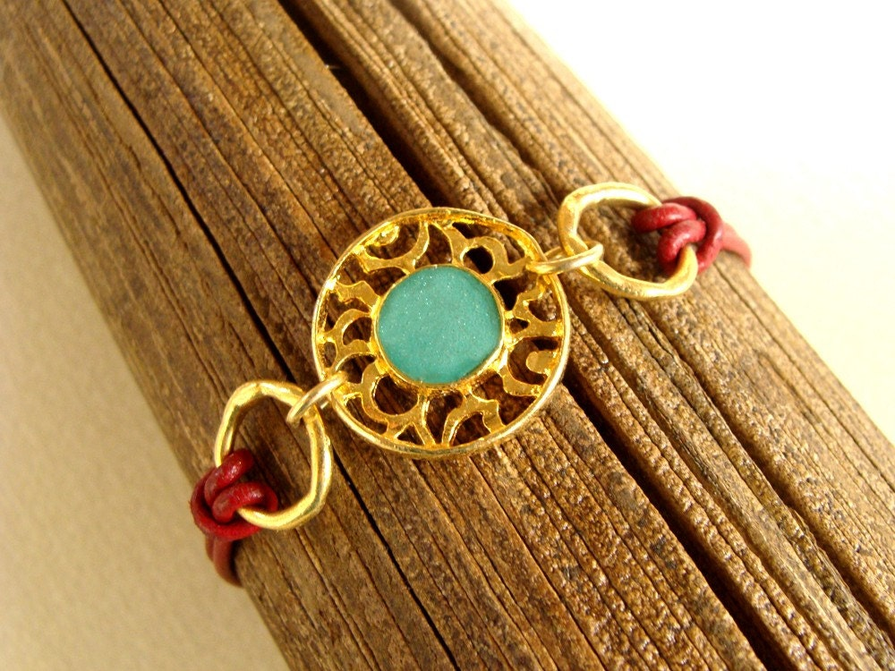 Gold & turquoise bracelet with red leather