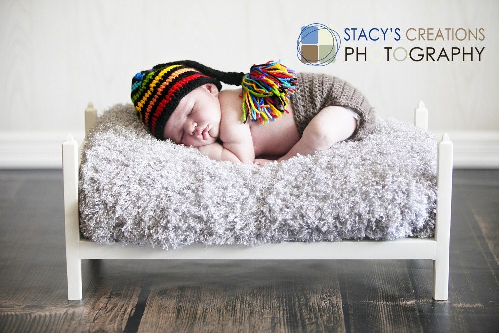 Rainbow and black striped Elf hat. 0-12 month.Great for a newborn photo prop or for a gift.