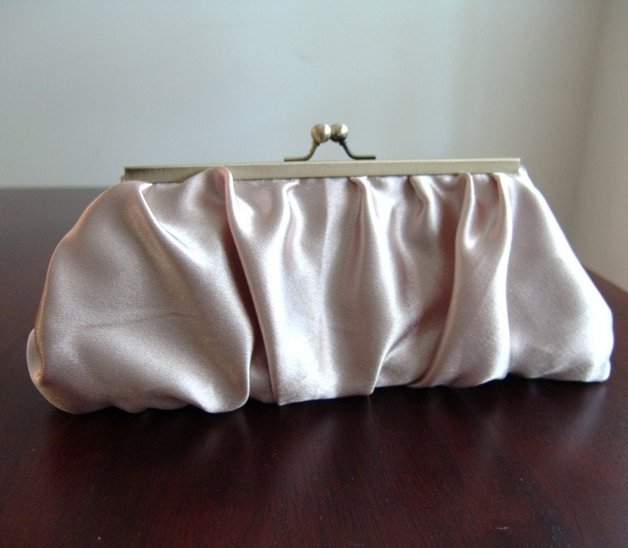 Satin clutch in purse frame. Gathered champagne