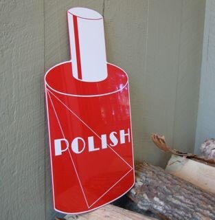 vintage bottle shape sign for nail polish