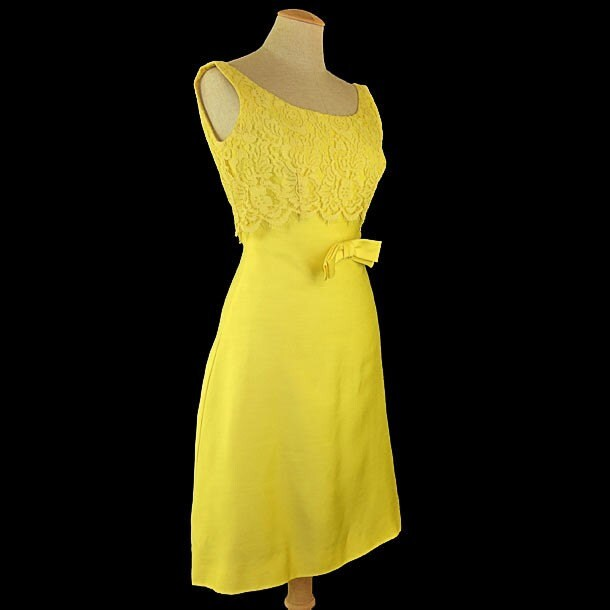 Etsy :: mysweetiepiepie :: VINTAGE 1960's Woman's Dress... Sunny Sleeveless Yellow Fitted Empire Waist, Scoop Neck Sheath Dress with Lace, Bow and Flared Skirt... Size Small from etsy.com