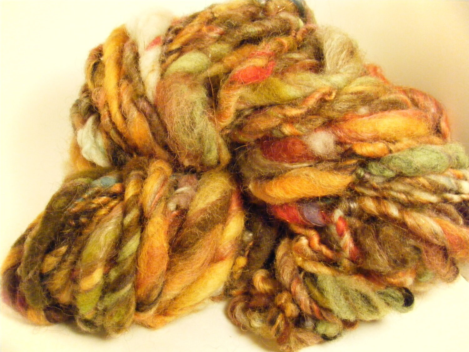Goldenrod handspun hand dyed art yarn thick and thin singles