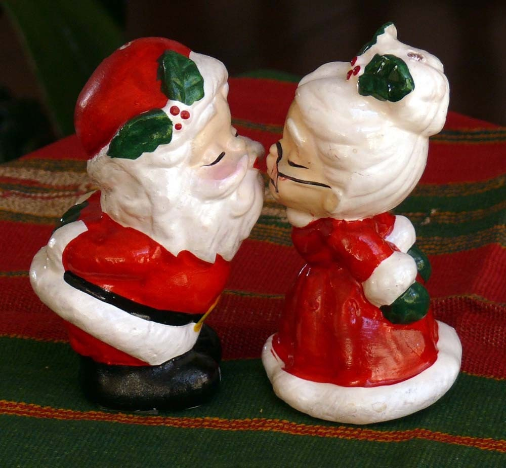 Vintage christmas kissing mr and mrs santa claus by