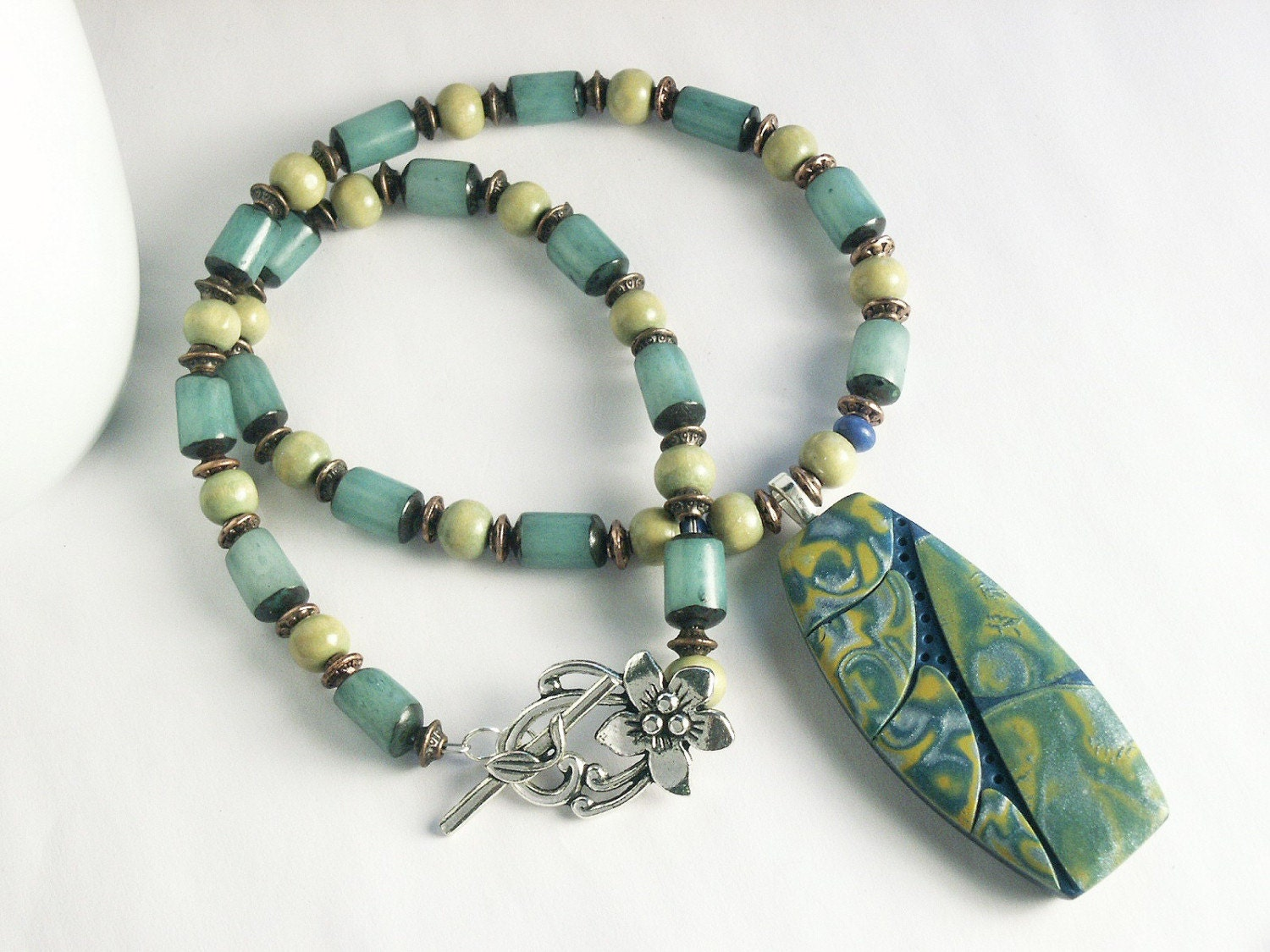 Handmade Beaded Necklace featuring Polymer Clay Pendant in Tropical Leaf Design