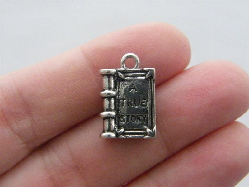 BULK 20 A true story book pendants antique silver tone PT2