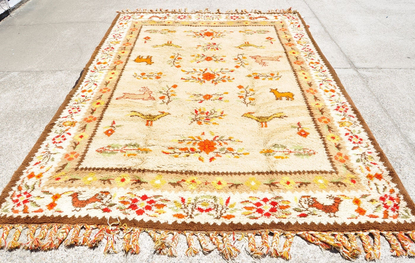 colorful moroccan rug covered in bounding by