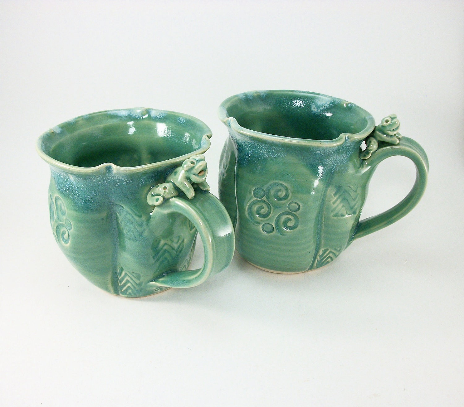 pair of jade colored frog mugs sold together