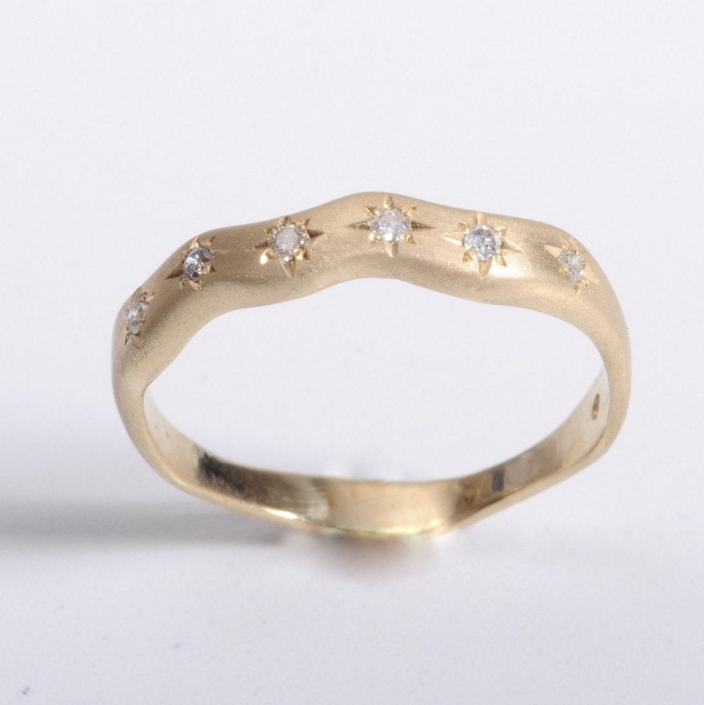Choice 5 wavy band with star things and diamonds Which wedding band goes