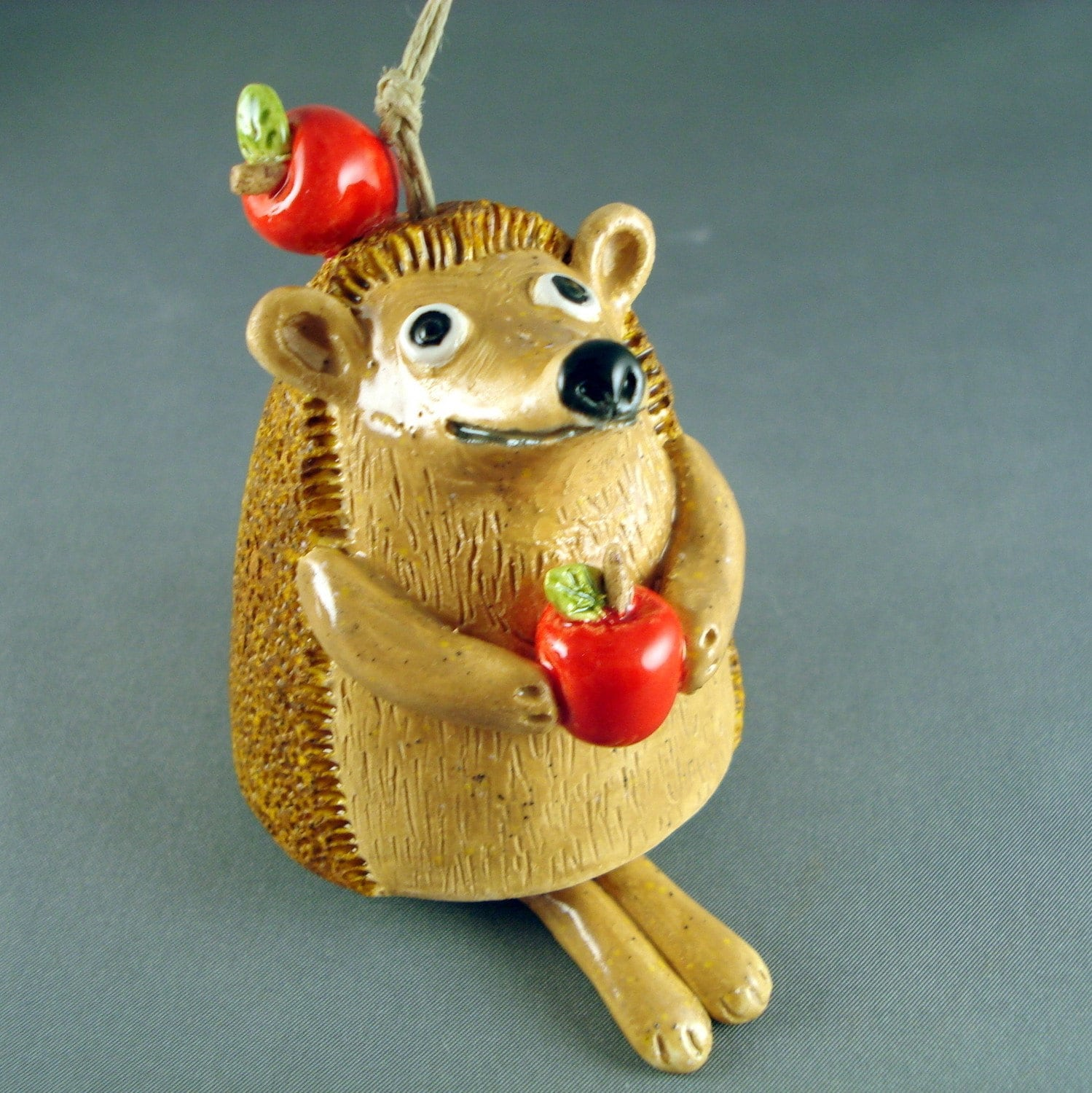 Ceramic bell sculpture Little Hedgehog with apples