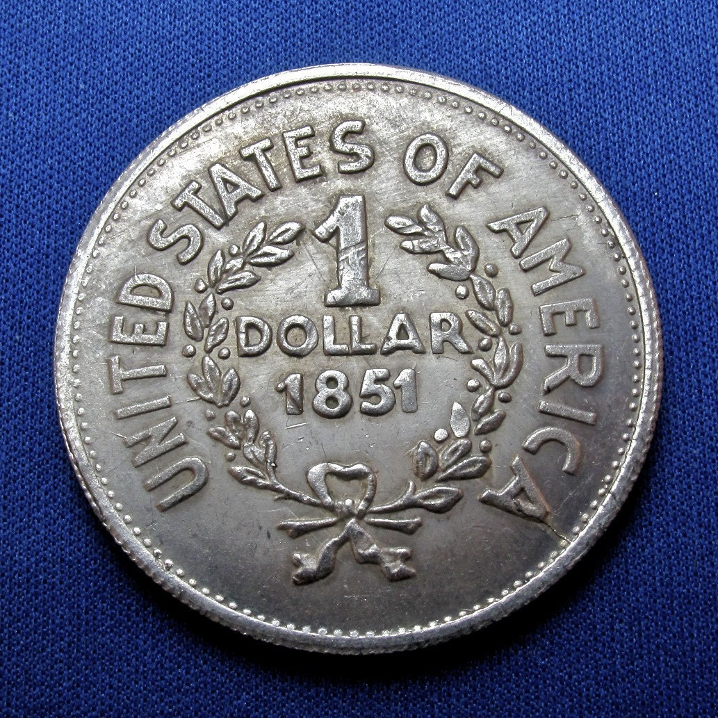 old counterfeit 1851 united states 1 dollar coin by