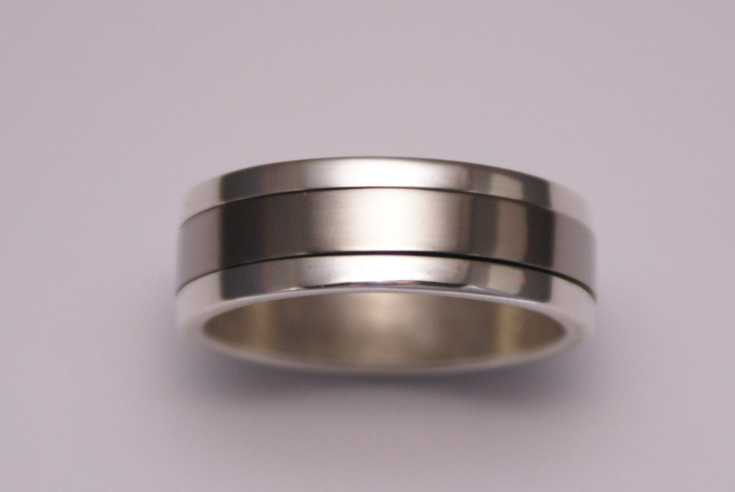 silver and titanium spinning rings by tristanbrazier on etsy