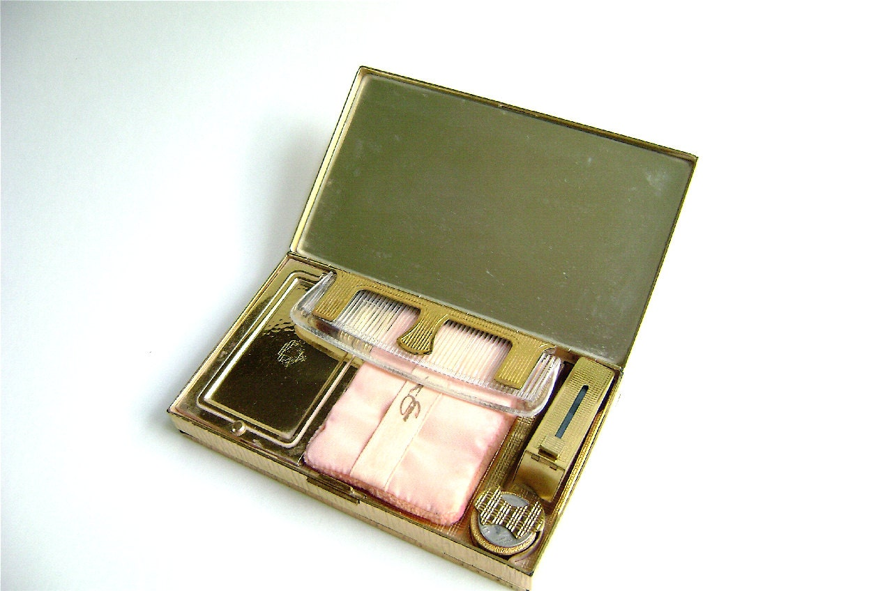 compact purse with all original parts including lipstick, powder, and comb