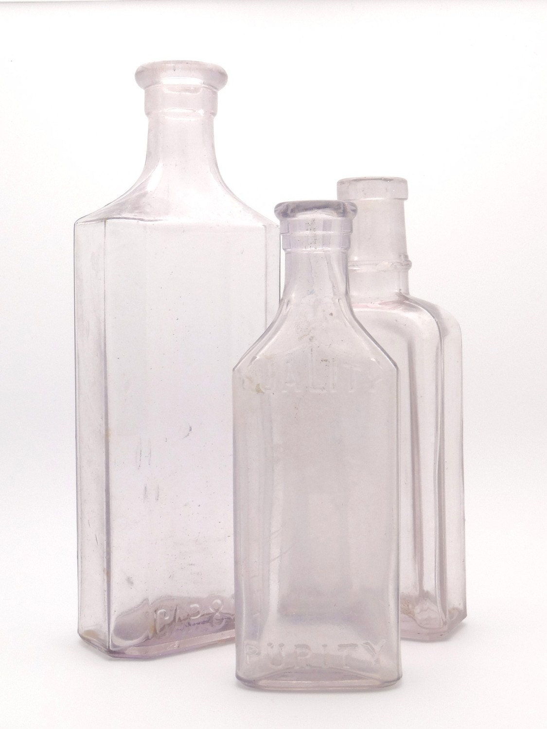 Three  Light Purple Vintage Glass Bottles