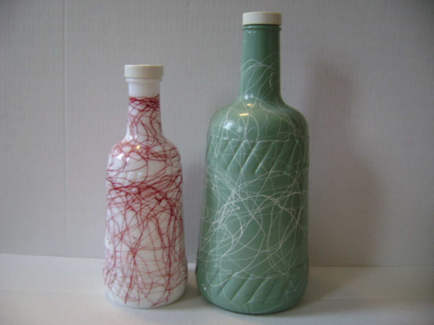 2 Vintage 1950s Hazel Atlas Splatter Painted Wine Bottles or  Liquid Storage Bottles White Milk Glass with Red Paint Clear Painted Green