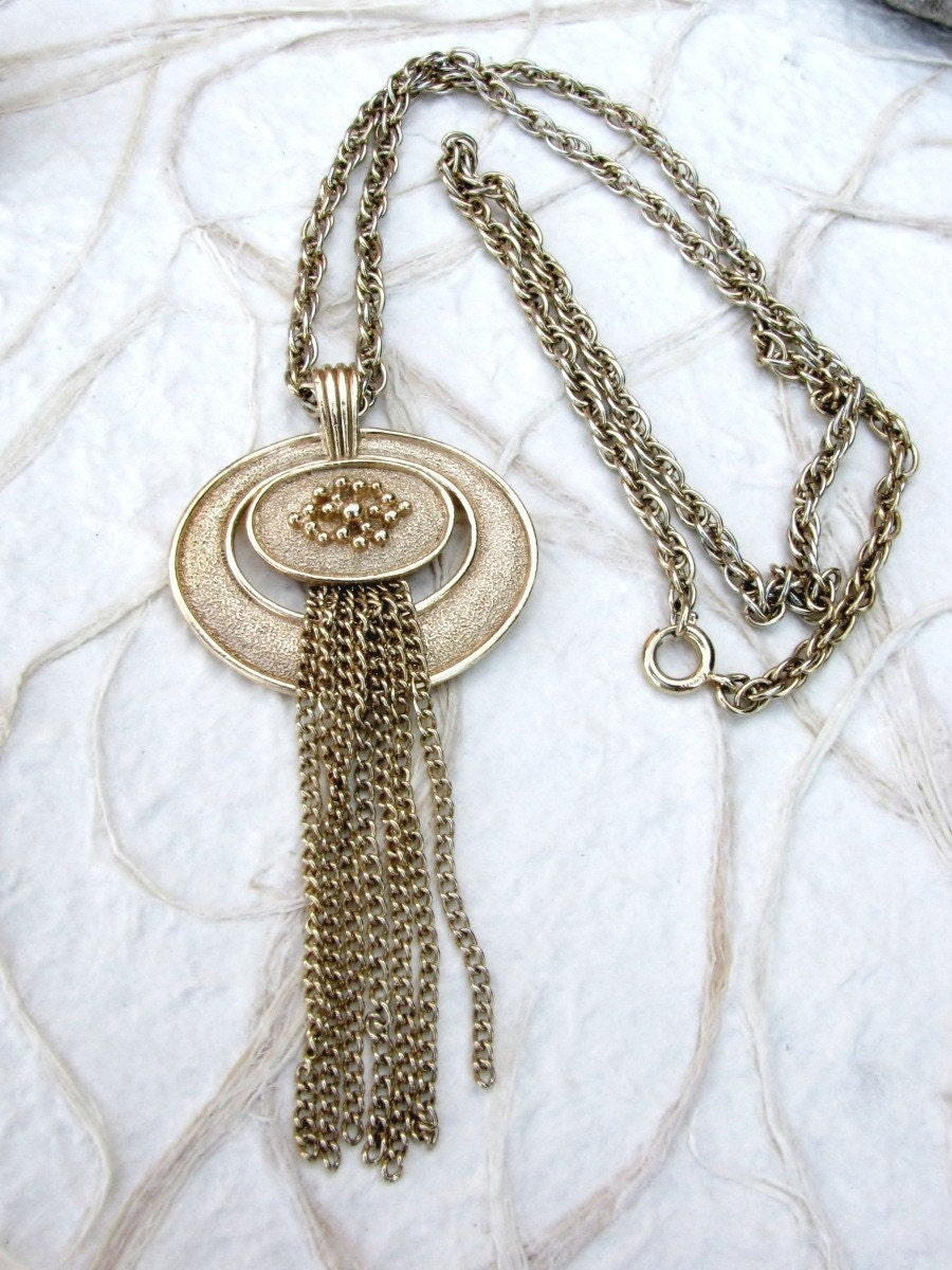 Vintage Gold Tone Avon Tassel Pendant on by BajunaJewelryVintage from etsy.com