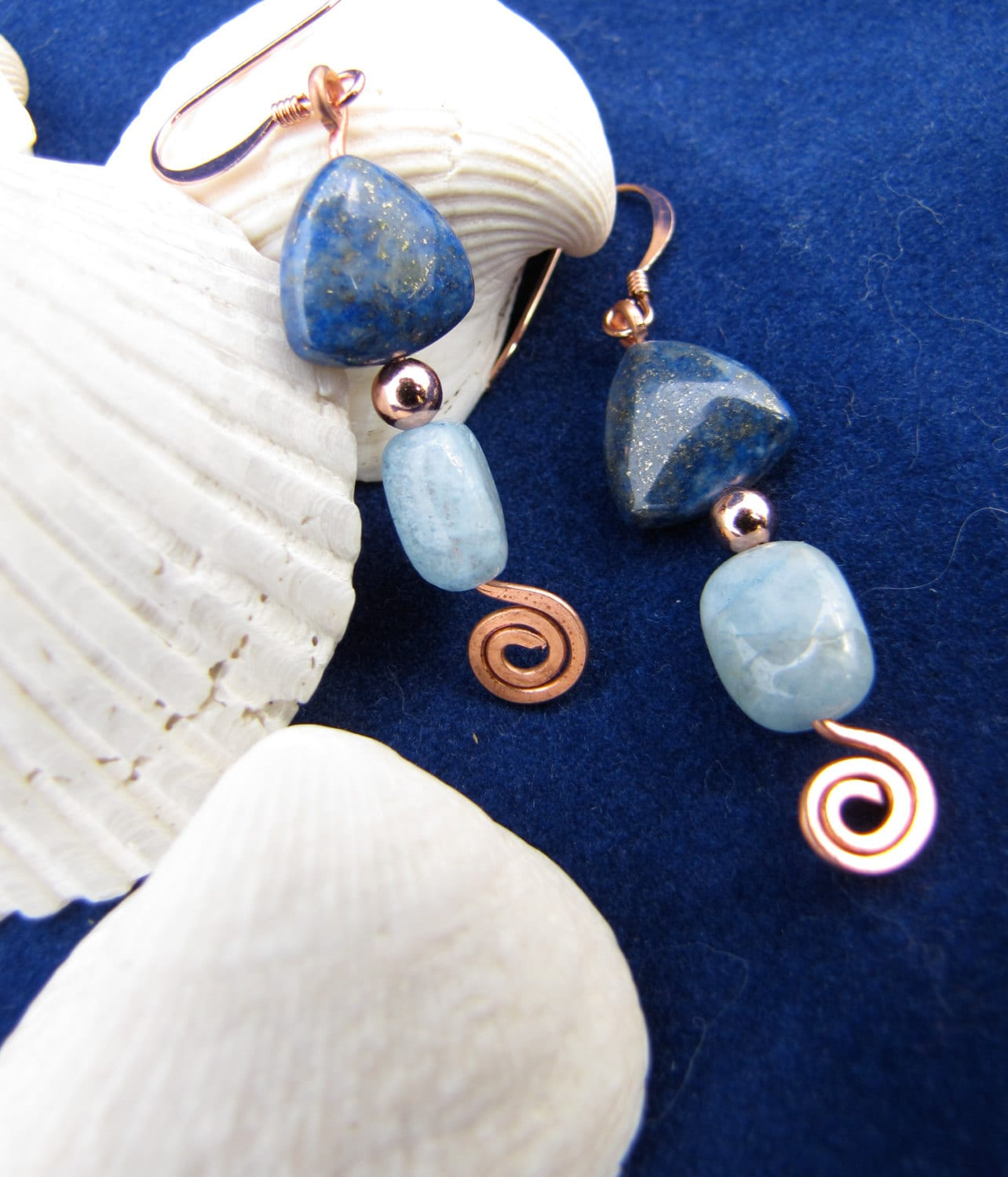 Philosopher's Stone Earrings: triangular deep blue lapis lazuli (with significant copper-colored inclusions), shiny copper spacer bead, long rectangular light-blue aquamarine, with a hammered-flat copper wire spiral at the bottom of each earring.