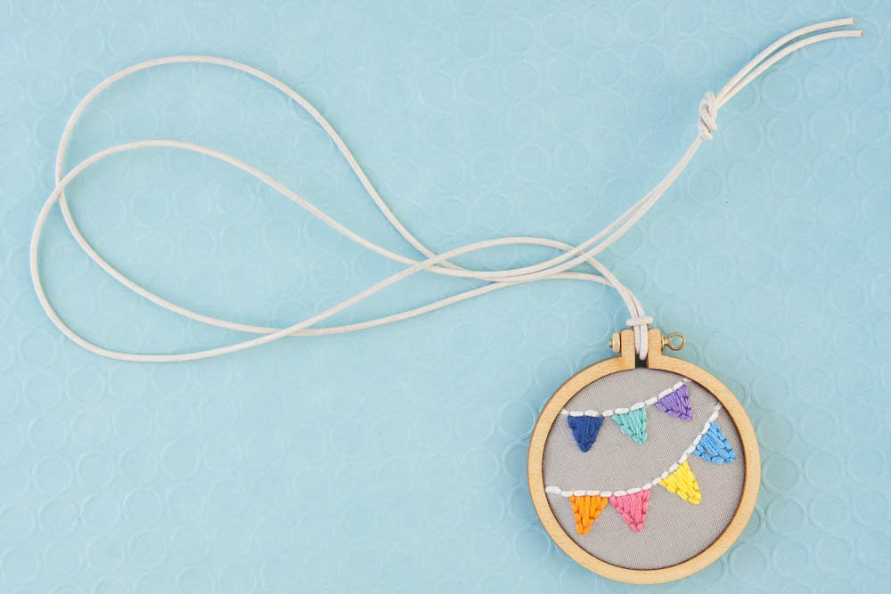 Bunting embroidery hoop necklace - navy, spearmint, purple, orange, pink, yellow, blue - miniature hoop - made with love by dandelyne