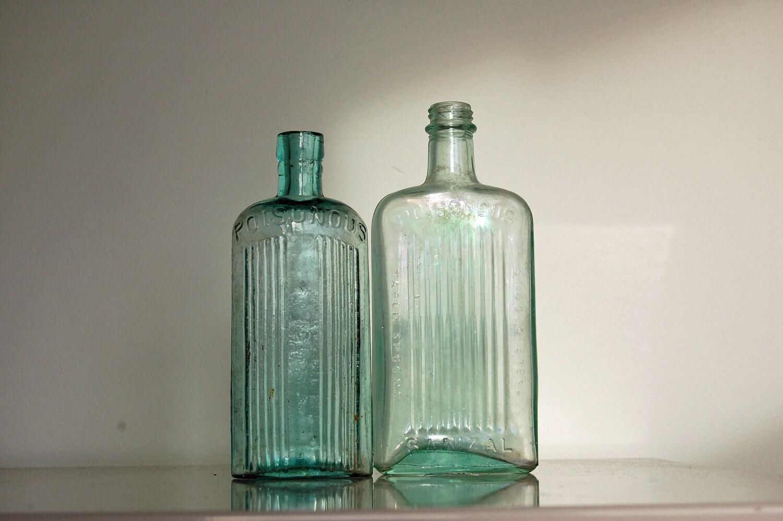 Aqua glass bottles vintage poison bottle two antique by for Uses for old glass bottles