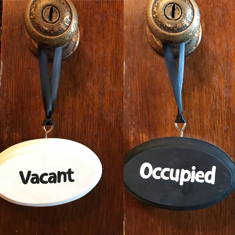 Occupied bathroom sign