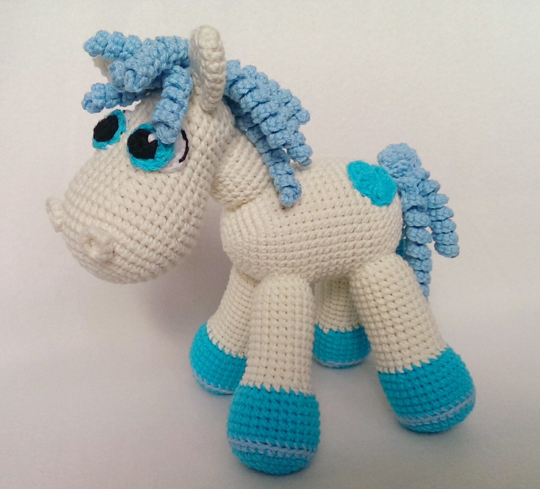 Hand made amigurumi toy pony. Hand crocheted horse made with soft acrylic yarn.