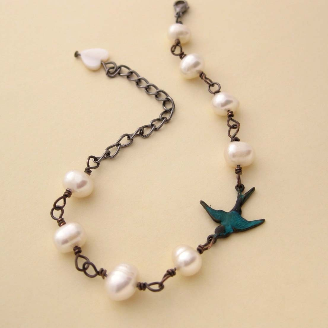 One Swallow Bracelet, freshwater pearls, antiqued teal bird, mother of pearl, wire wrapped