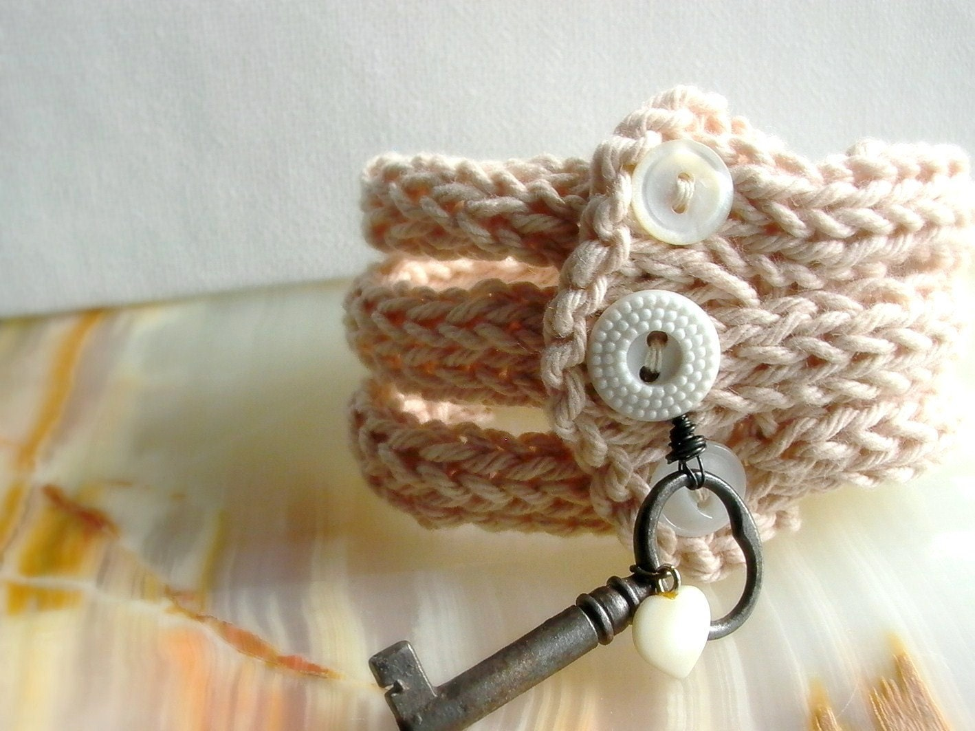 Forever in my Heart Secret Love . handknit bangles with vintage trinkets