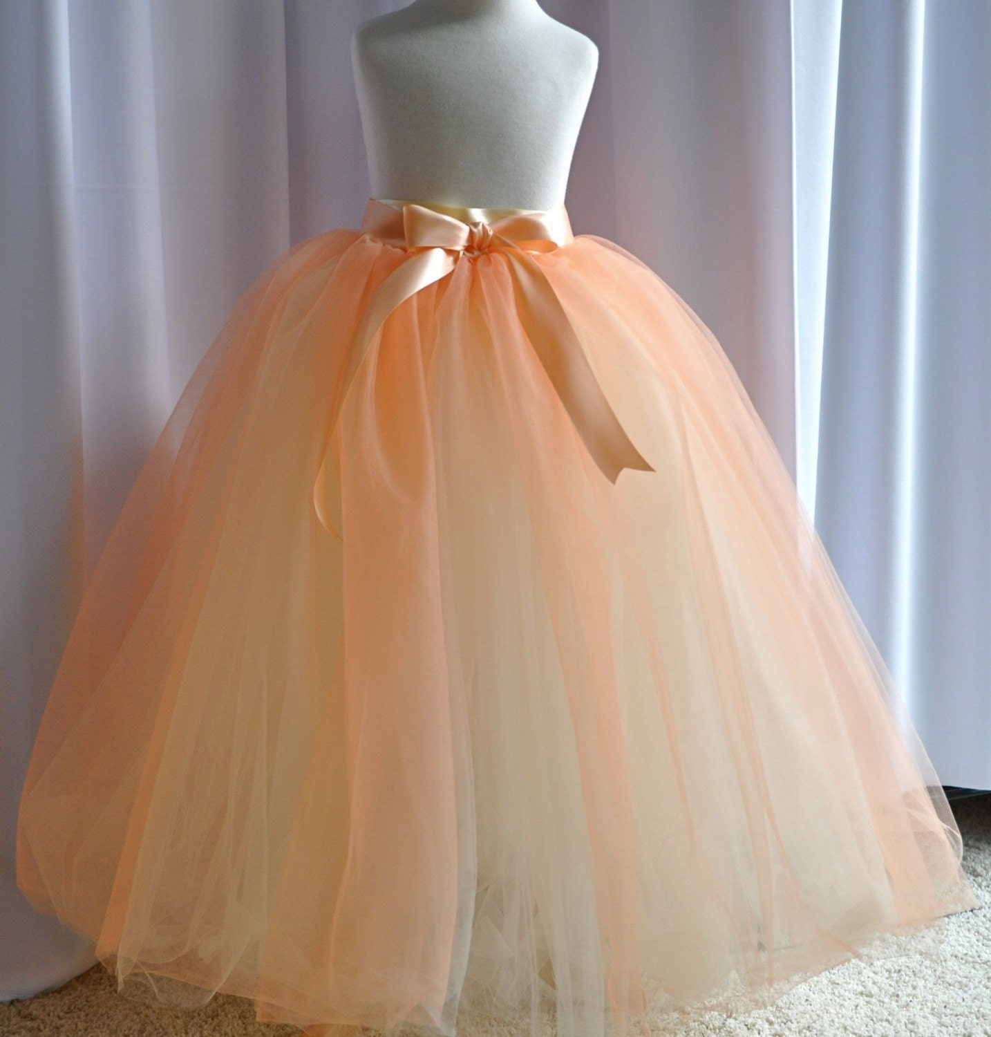 Peaches and Cream Flower Girl Tutu for Weddings. Available in several color combinations. This is a two in one tutu and reverses. 26 inches long. Princess length on little girls. Entirely sewn tutu.