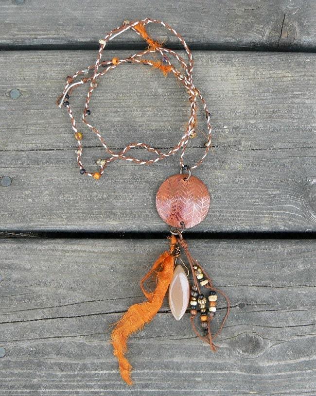 Primitive orange fishbone patterned pendant necklace with beaded plaited hemp cord