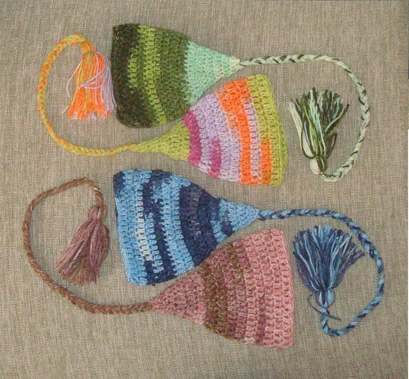 Customize your own Elf Hat of sectional colored acrylic yarn. Sizes 0-12 month.