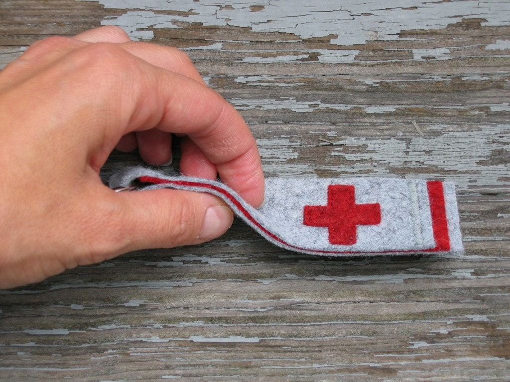 a key fob with red cross