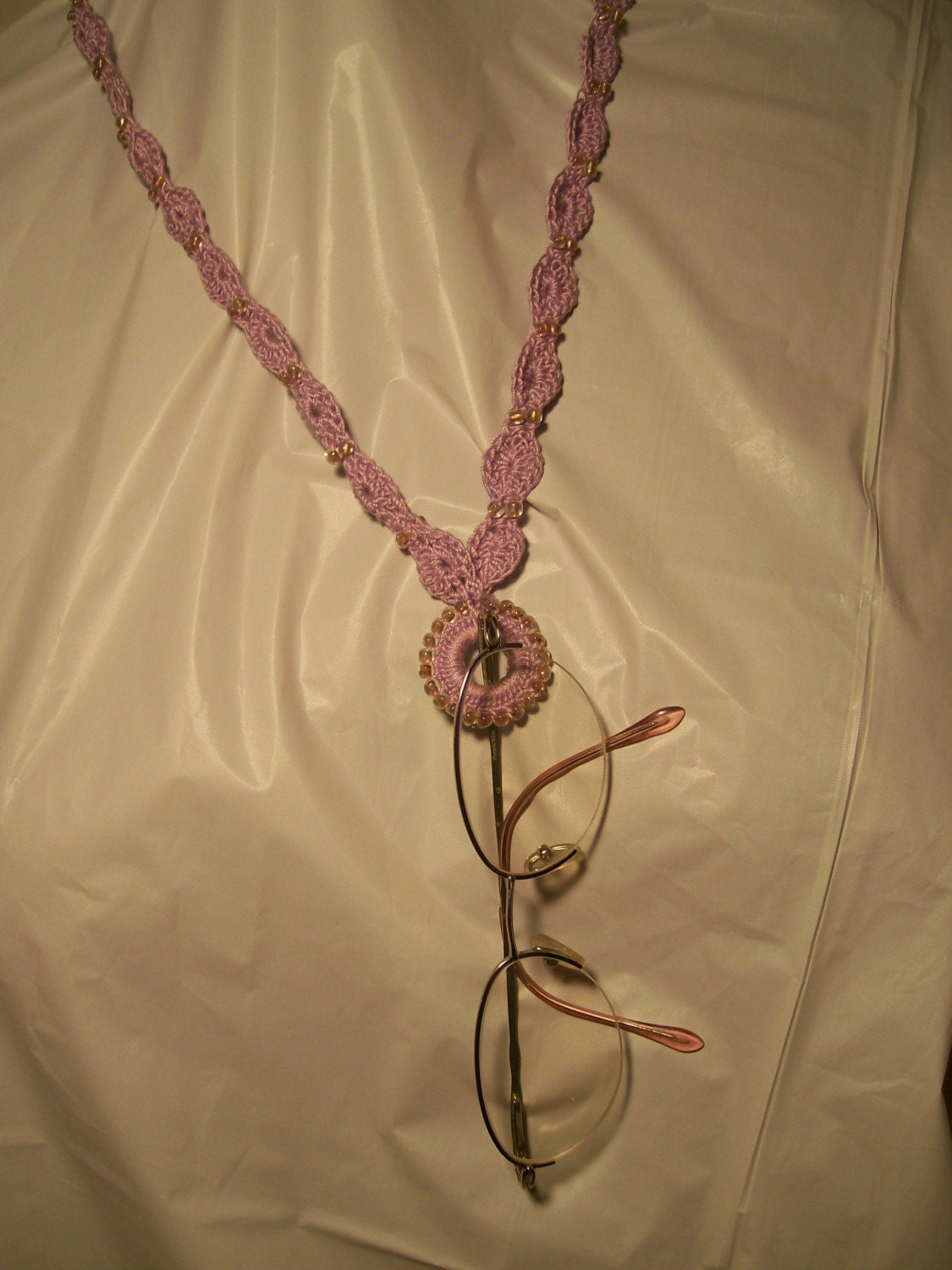 Necklace and eyeglass holder