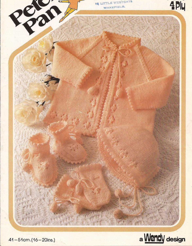 Turuncu bebek hırkası, şapkası ve patiği
