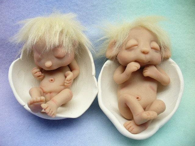 Clay sculptures of babies