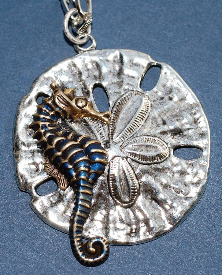 Seahorse on a Sand Dollar / Starfish Necklace by ArtMadeByTammy from etsy.com