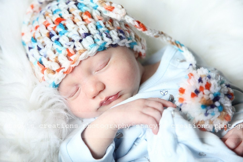 Cute motley Elf hat with pom pom. 0-12 month. Great for a newborn photo prop or for a gift. Item 057 Confetti