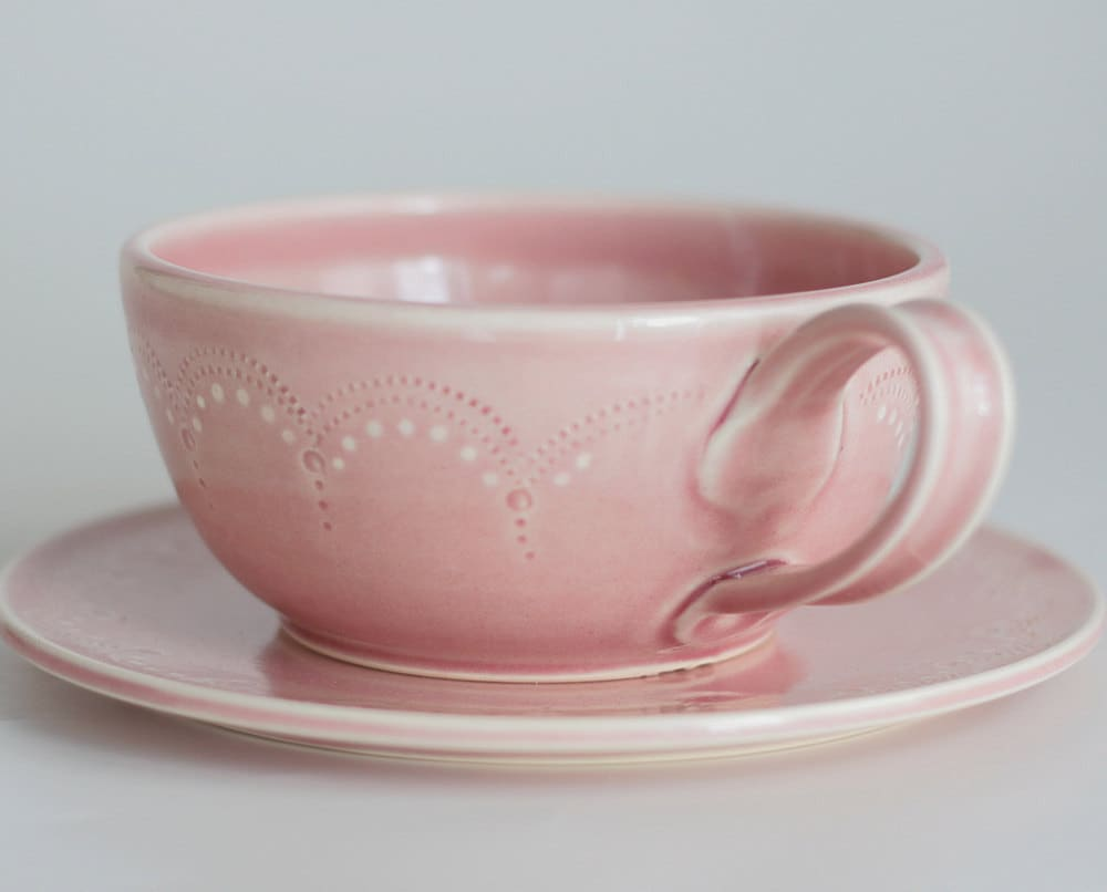Oversized teacup and saucer set... scallop stitching in pink.