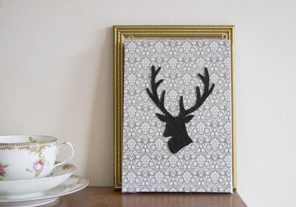 Leather stag silhouette on canvas