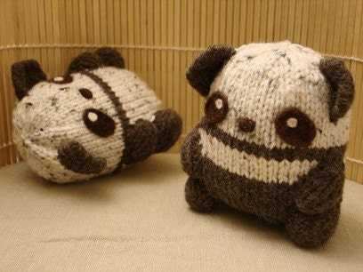 cute, knitted, brown & white panda twins.