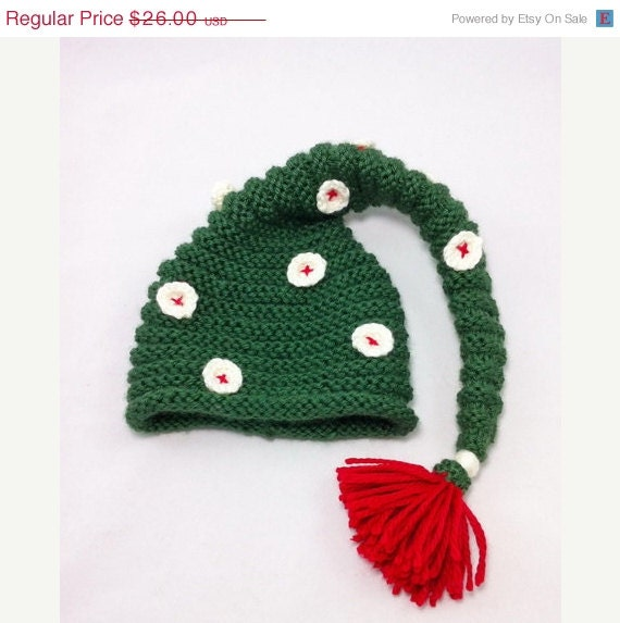 ON SALE Newborn dark green knitted baby hat, pixie hat, elf hat, with crocheted buttons and red tassel, photo prop - BitsOfFiber