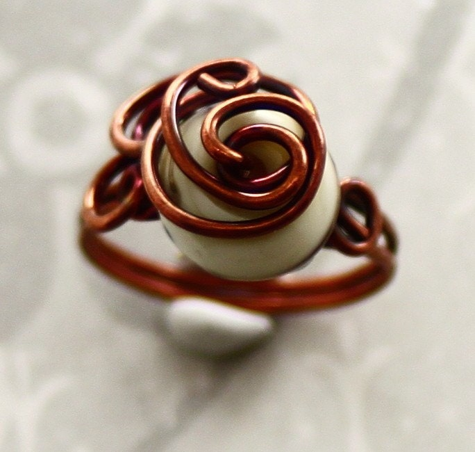 Ivory lampwork glass wrapped with solid copper wire ring. Size 7.5