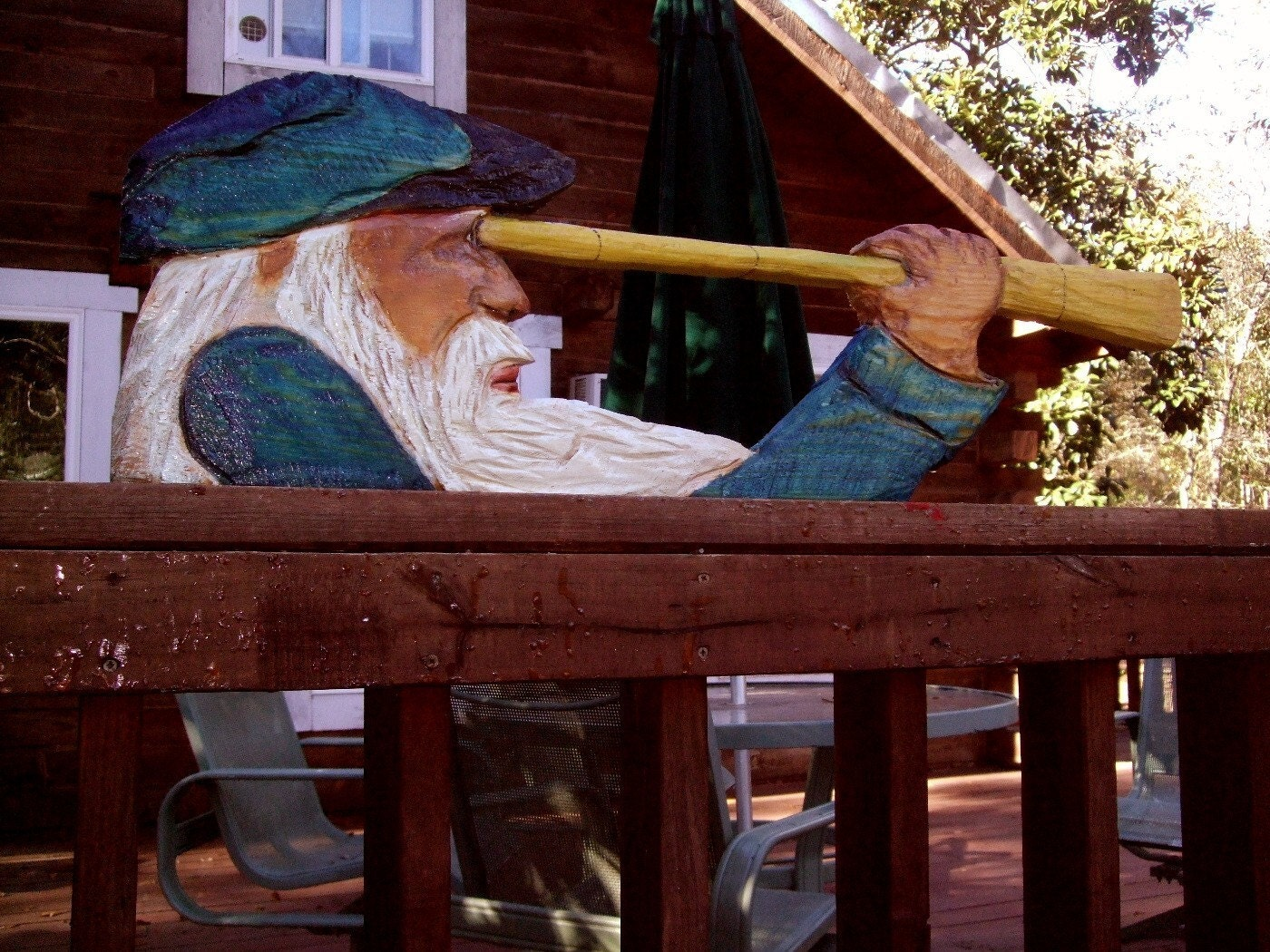 Sea captain w telescope chainsaw wood carved by