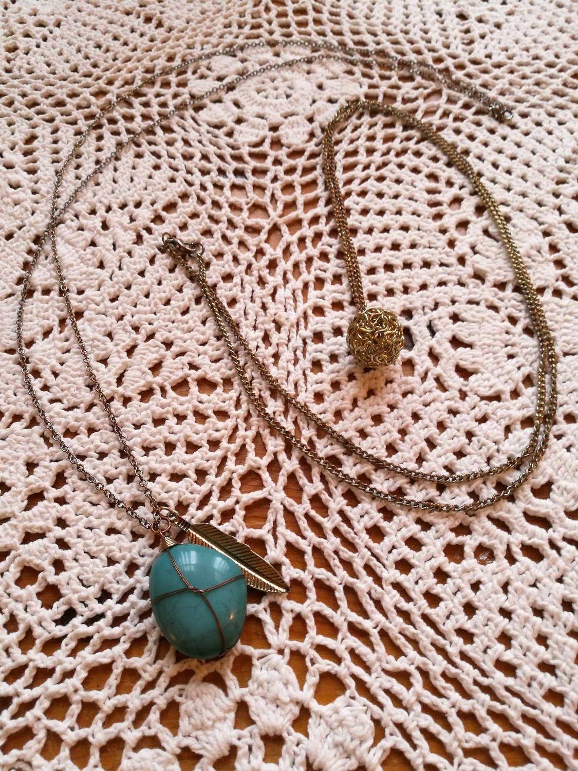 Long chain necklace wire wrapped turquoise with feather charm also a wire mesh ball necklace 1990s jewellery.