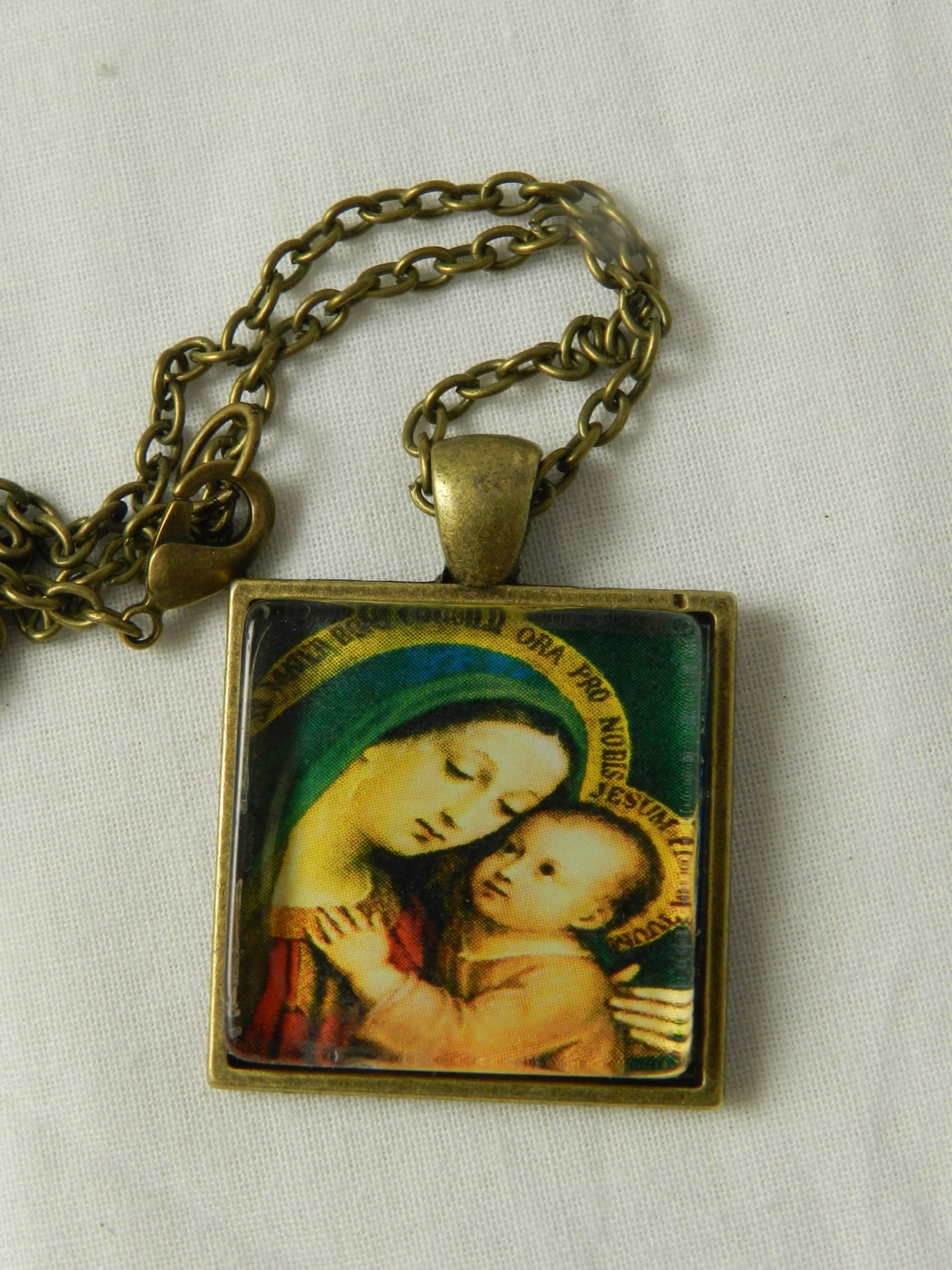 Items similar to holy mother virgin mary baby jesus religious glass