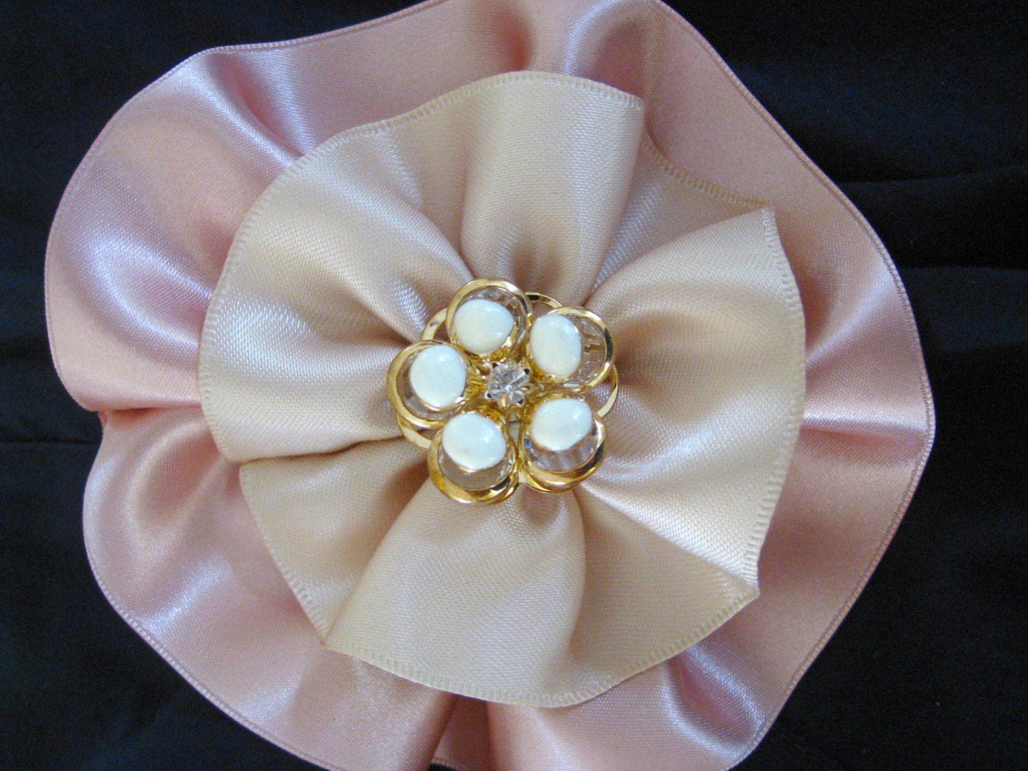 two tone beige and rose colored ribbon rosette