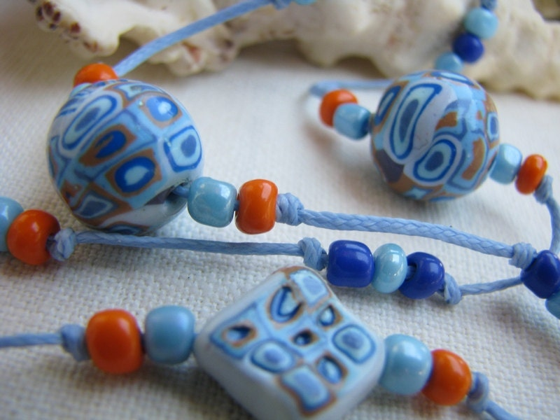 Necklace and ring, retro hippie in pastel blue, dark blue, gray blue and light brown - ocher
