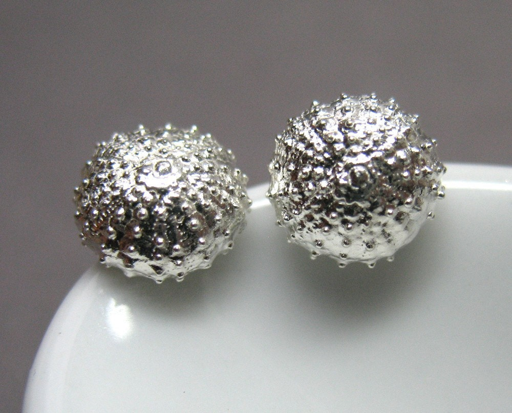 Tiny sterling silver sea urchins by AnnieLesperance from etsy.com