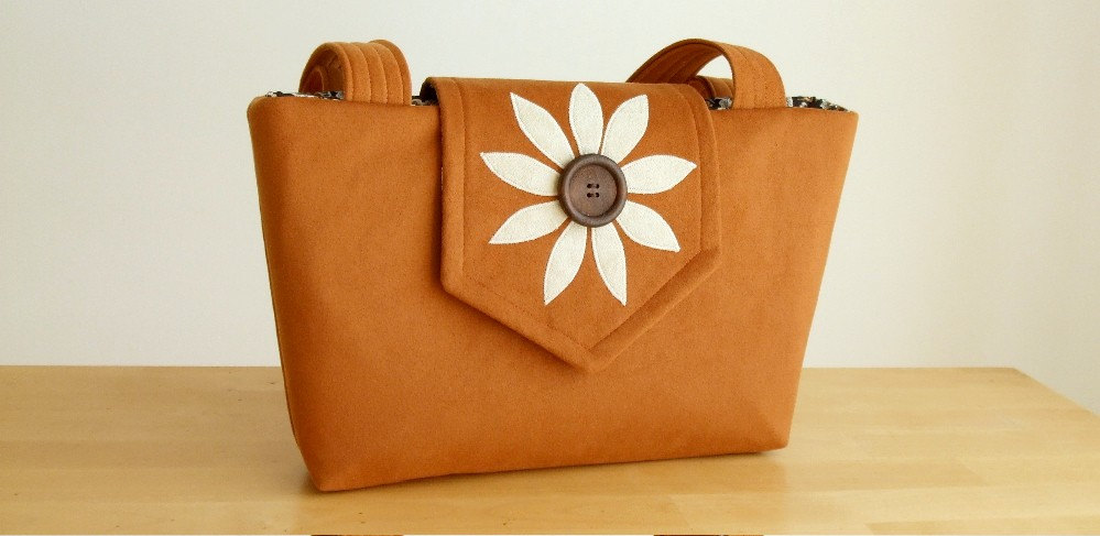 The Wayfarer Purse in Faux Suede with a Flower Applique