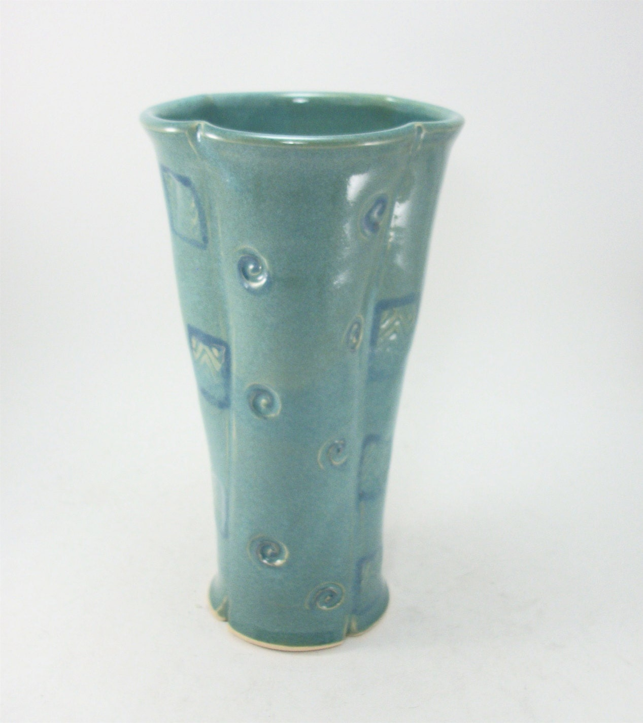 tall skinny turquoise or teal vase